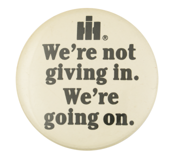 We're Not Giving In Advertising Button Museum
