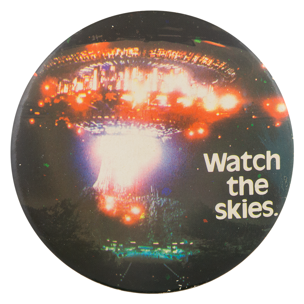 https://www.buttonmuseum.org/sites/default/files/EN-watch-the-skies-close-encounters-of-the-third-kind-button-busy-beaver-button-museum.png